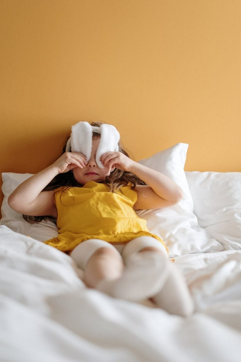 Young girl using rabbit ear headband to cover her eyes