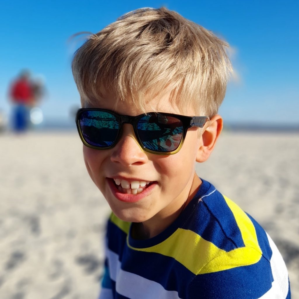 boy on beach with sunglasses