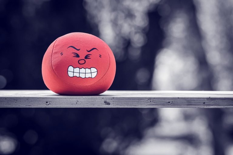 red ball with stress face